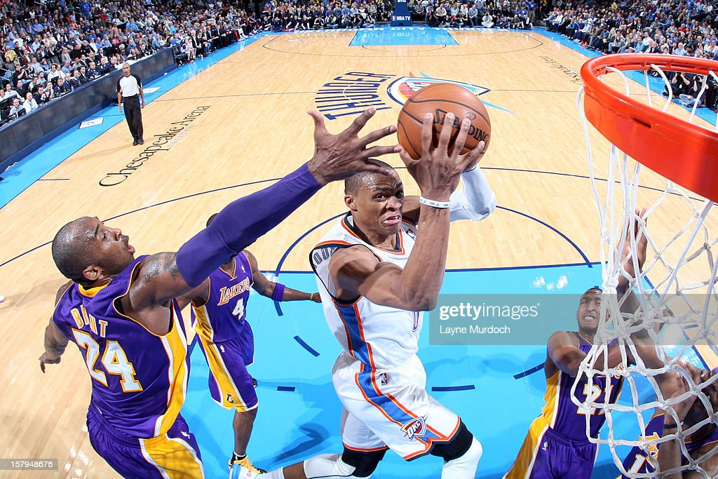 Russell Westbrook #0 of the Oklahoma City Thunder shoots over Kobe Bryant #24 of the Los Angeles Lakers during an NBA game on December 7, 2012 at the Chesapeake Energy Arena in Oklahoma City, Oklahoma.