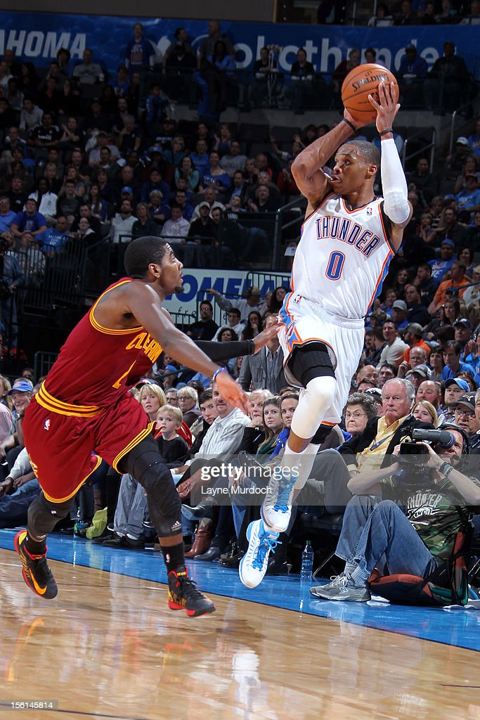 <a gi-track='captionPersonalityLinkClicked' href=/galleries/search?phrase=Russell+Westbrook&family=editorial&specificpeople=4044231 ng-click='$event.stopPropagation()'>Russell Westbrook</a> #0 of the Oklahoma City Thunder shoots over <a gi-track='captionPersonalityLinkClicked' href=/galleries/search?phrase=Kyrie+Irving&family=editorial&specificpeople=6893971 ng-click='$event.stopPropagation()'>Kyrie Irving</a> #2 of the Cleveland Cavaliers during an NBA game on November 11, 2012 at the Chesapeake Energy Arena in Oklahoma City, Oklahoma.