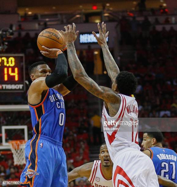 Russell Westbrook of the Oklahoma City Thunder shoots over Lou Williams of the Houston Rockets during Game Five of the Western Conference...
