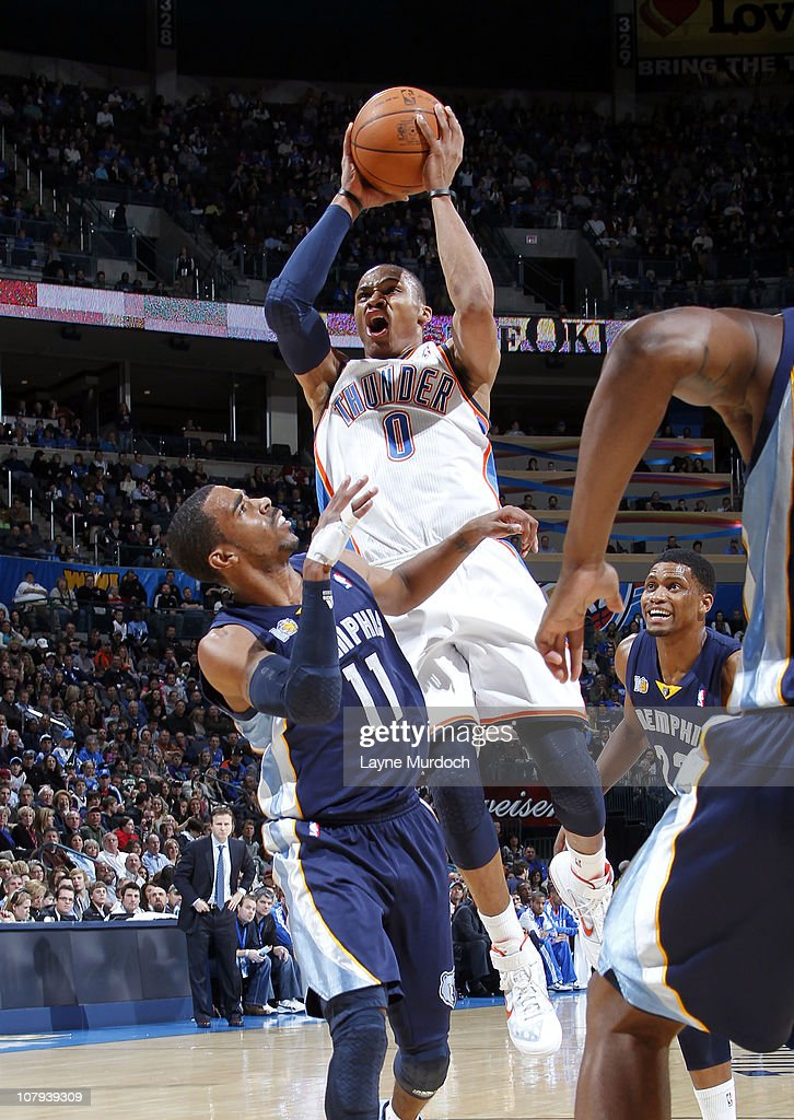 Russell Westbrook #0 of the Oklahoma City Thunder shoots over Mike Conley #11 of the Memphis Grizzlies on January 8, 2011 at the Ford Center in Oklahoma City, Oklahoma.