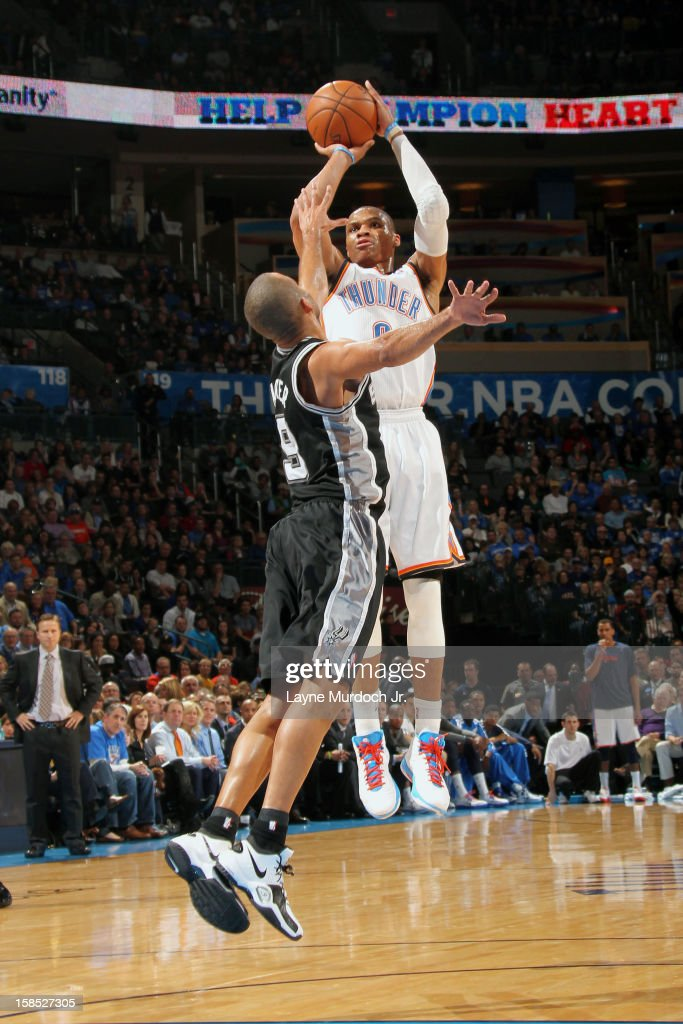 <a gi-track='captionPersonalityLinkClicked' href=/galleries/search?phrase=Russell+Westbrook&family=editorial&specificpeople=4044231 ng-click='$event.stopPropagation()'>Russell Westbrook</a> #0 of the Oklahoma City Thunder shoots over Tony Parker #9 of the San Antonio Spurs during an NBA game on December 17, 2012 at the Chesapeake Energy Arena in Oklahoma City, Oklahoma.