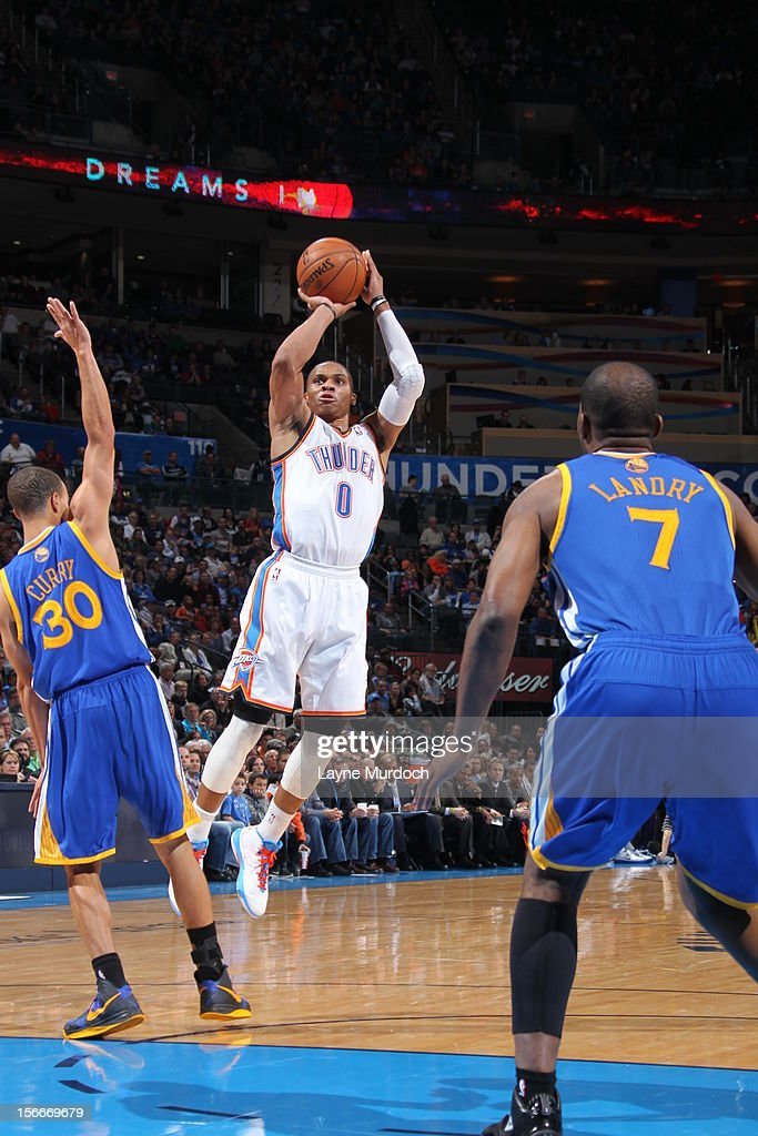 <a gi-track='captionPersonalityLinkClicked' href=/galleries/search?phrase=Russell+Westbrook&family=editorial&specificpeople=4044231 ng-click='$event.stopPropagation()'>Russell Westbrook</a> #0 of the Oklahoma City Thunder shoots the ball a jumper during the game between the Oklahoma City Thunder and the Golden State Warriors on November 18, 2012 at the Chesapeake Energy Arena in Oklahoma City, Oklahoma.