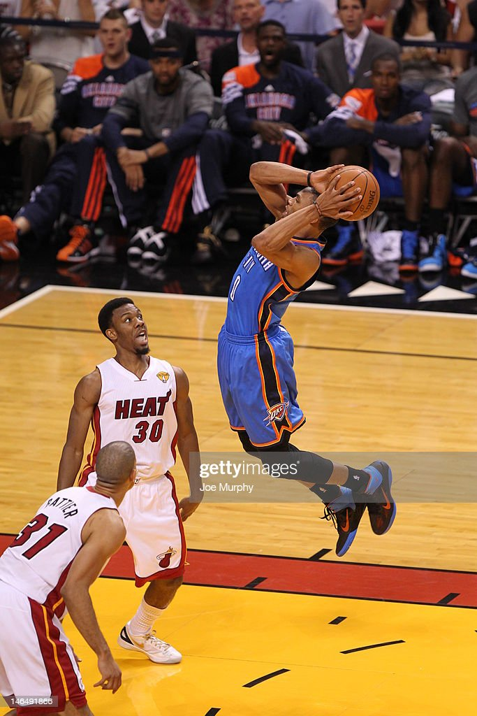 Russell Westbrook of the Oklahoma City Thunder shoots the ball against Norris Cole of the Miami Heat during Game Three of the 2012 NBA Finals between...