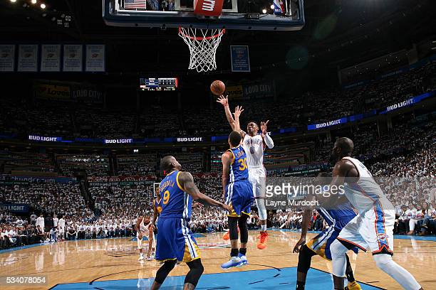 Russell Westbrook of the Oklahoma City Thunder shoots the ball during the game tate Warriors in Game Four of the Western Conference Finals during the...