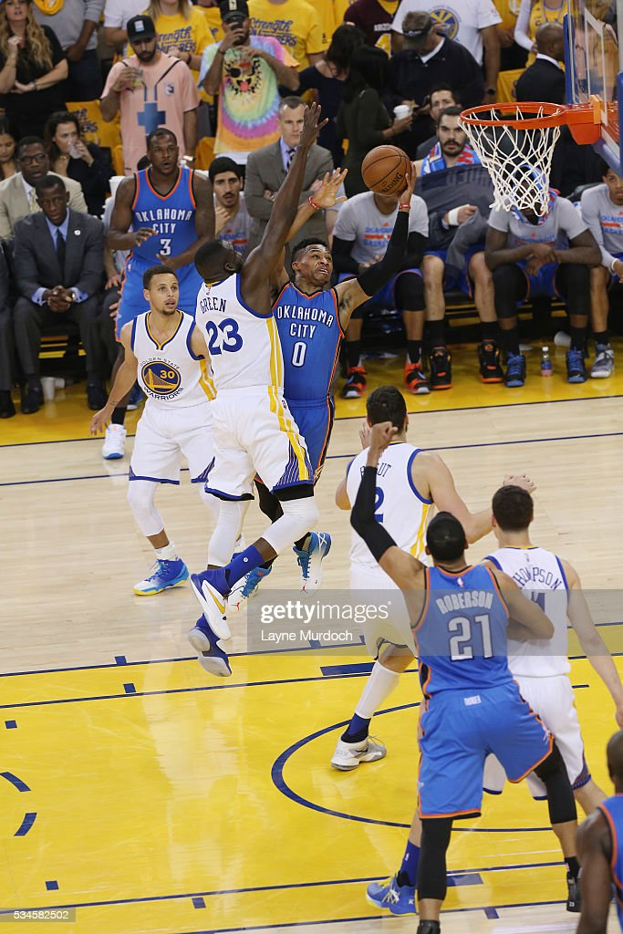 <a gi-track='captionPersonalityLinkClicked' href=/galleries/search?phrase=Russell+Westbrook&family=editorial&specificpeople=4044231 ng-click='$event.stopPropagation()'>Russell Westbrook</a> #0 of the Oklahoma City Thunder shoots the ball against <a gi-track='captionPersonalityLinkClicked' href=/galleries/search?phrase=Draymond+Green&family=editorial&specificpeople=5628054 ng-click='$event.stopPropagation()'>Draymond Green</a> #23 of the Golden State Warriors in Game Five of the Western Conference Finals during the 2016 NBA Playoffs on May 26, 2016 at ORACLE Arena in Oakland, California.
