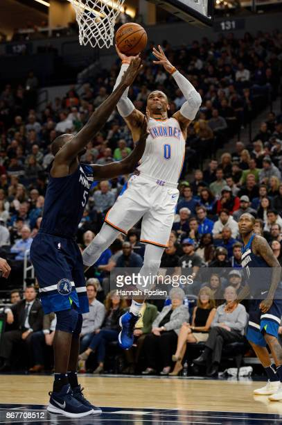 Russell Westbrook of the Oklahoma City Thunder shoots the ball against Gorgui Dieng of the Minnesota Timberwolves during the game on October 27 2017...