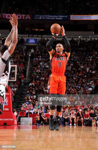 Russell Westbrook of the Oklahoma City Thunder shoots the ball against the Houston Rockets during the game on March 26 2017 at the Toyota Center in...