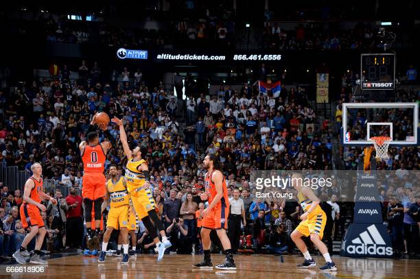 Russell Westbrook of the Oklahoma City Thunder shoots the ball to win the game against the Denver Nuggets on April 9 2017 at the Pepsi Center in...