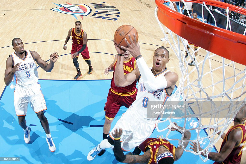 <a gi-track='captionPersonalityLinkClicked' href=/galleries/search?phrase=Russell+Westbrook&family=editorial&specificpeople=4044231 ng-click='$event.stopPropagation()'>Russell Westbrook</a> #0 of the Oklahoma City Thunder shoots the ball vs the Cleveland Cavaliers during an NBA game on November 11, 2012 at the Chesapeake Energy Arena in Oklahoma City, Oklahoma.