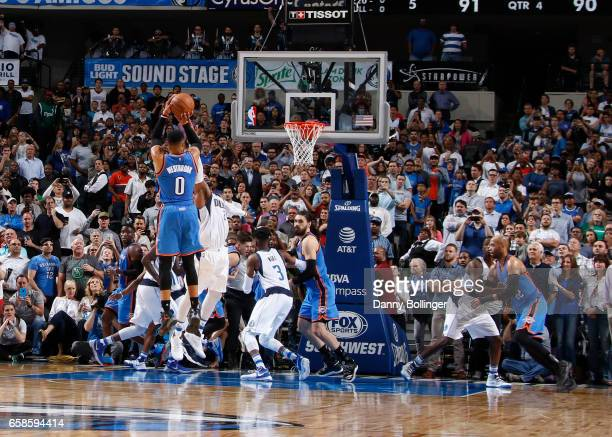 Russell Westbrook of the Oklahoma City Thunder shoots the gamewinning basket during a game against the Dallas Mavericks on March 27 2017 at American...