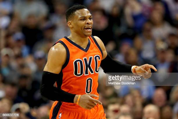 Russell Westbrook of the Oklahoma City Thunder shouts instructions to his team as he runs to the opposite end of the floor while playing the Denver...