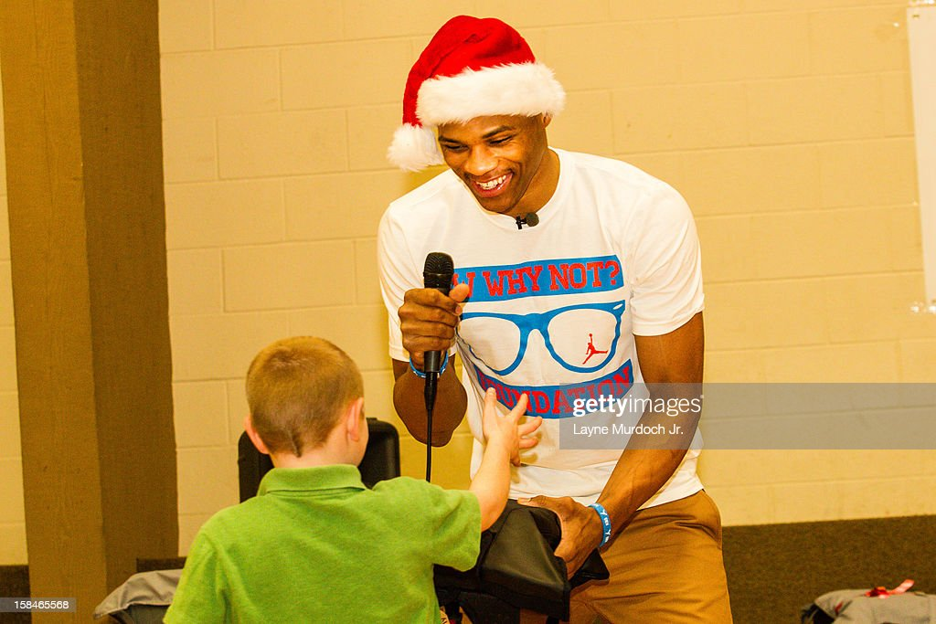 Russell Westbrook #0 of the Oklahoma City Thunder showcased his newly formed WHY NOT? Foundation by surprising eighty Oklahoma City children living in foster care at All Souls Episcopal Church on December 16, 2012 in Oklahoma City, Oklahoma.