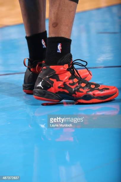 Russell Westbrook of the Oklahoma City Thunder showcases his sneakers against the Memphis Grizzlies In Game Five of the Western Conference...