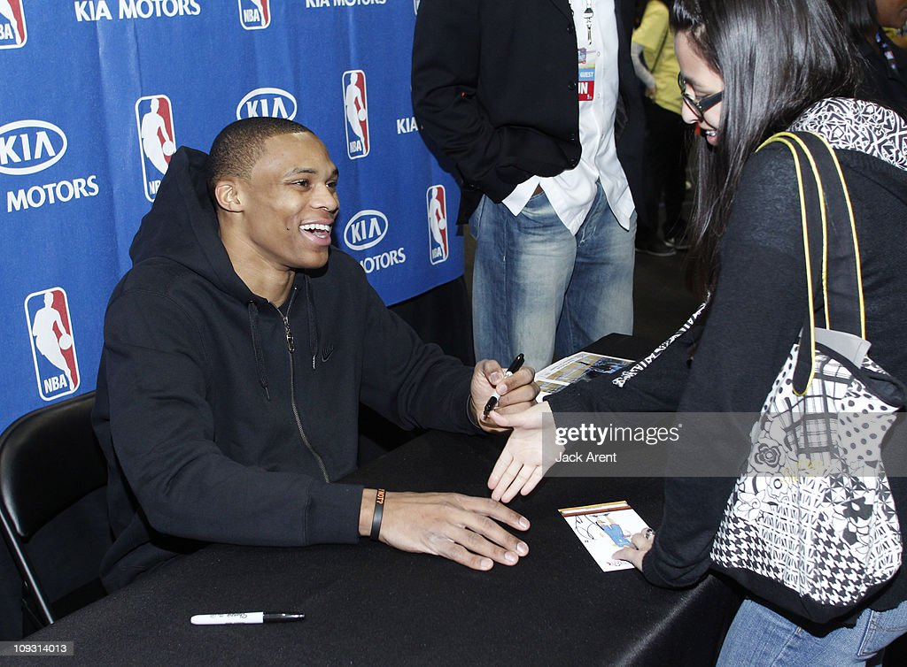 <a gi-track='captionPersonalityLinkClicked' href=/galleries/search?phrase=Russell+Westbrook&family=editorial&specificpeople=4044231 ng-click='$event.stopPropagation()'>Russell Westbrook</a> of the Oklahoma City Thunder signs autographs at the Kia court during Jam Session presented by Adidas during All Star Weekend on February 20, 2011 in Los Angeles, California.