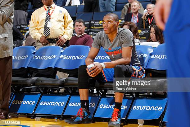 Russell Westbrook of the Oklahoma City Thunder sits on the bench during pregame warmups before facing the Golden State Warriors on February 7 2012 at...