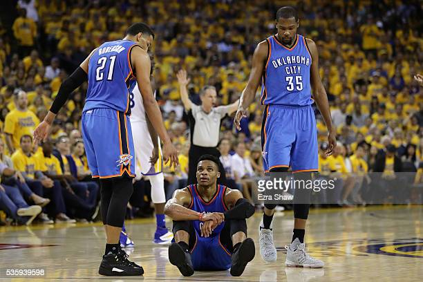Russell Westbrook of the Oklahoma City Thunder sits on the court after a play in Game Seven of the Western Conference Finals against the Golden State...
