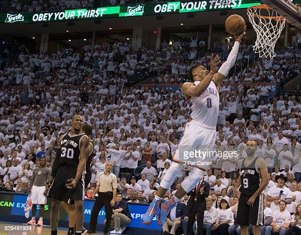 Russell Westbrook of the Oklahoma City Thunder slams dunks two points against the San Antonio Spurs during the second half of Game Four of the...