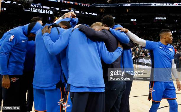 Russell Westbrook of the Oklahoma City Thunder stands apart from the team during huddle before the start of their game against the San Antonio Spurs...