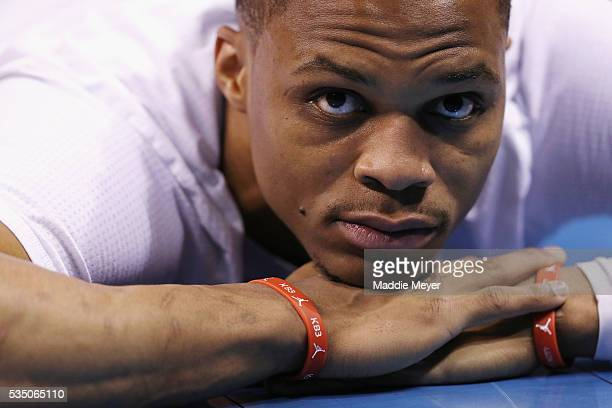 Russell Westbrook of the Oklahoma City Thunder stretches on the court prior to game six of the Western Conference Finals against the Golden State...
