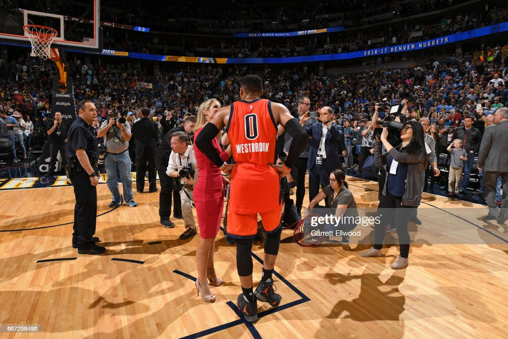 Russell Westbrook #0 of the Oklahoma City Thunder talks to the media after hitting the game winning shot and recording his record breaking 42nd triple-double of the year after the game against the Denver Nuggets on April 9, 2017 at the Pepsi Center in Denver, Colorado.
