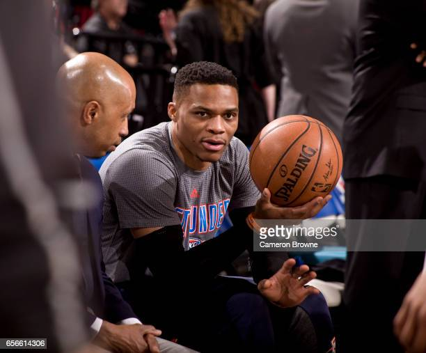 Russell Westbrook of the Oklahoma City Thunder talks with assistant coach during the game against the Portland Trail Blazers on March 2 2017 at the...
