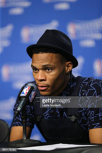 Russell Westbrook of the Oklahoma City Thunder talks with the press after the game tate Warriors in Game Four of the Western Conference Finals during...