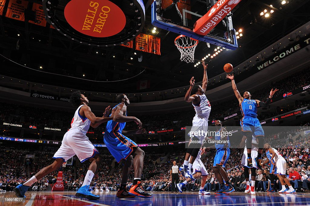 Russell Westbrook #0 of the Oklahoma City Thunder throws up the floater against the Philadelphia 76ers during the game at the Wells Fargo Center on November 24, 2012 in Philadelphia, Pennsylvania.