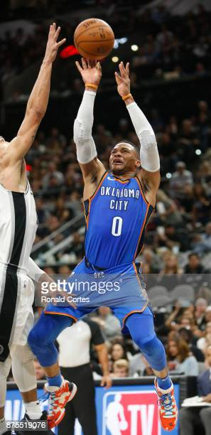 Russell Westbrook of the Oklahoma City Thunder tries to score against the San Antonio Spurs at ATT Center on November 17 2017 in San Antonio Texas...