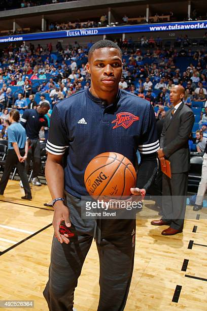 Russell Westbrook of the Oklahoma City Thunder warms up before a preseason game against the Dallas Mavericks on October 13 2015 at the BOK Center in...