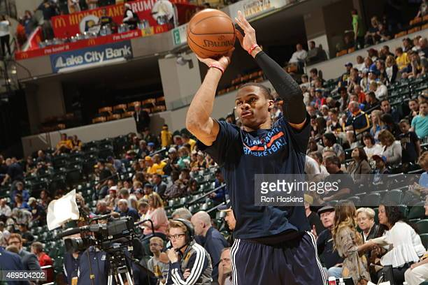 Russell Westbrook of the Oklahoma City Thunder warms up before the game against the Indiana Pacers during the game on April 12 2015 at Bankers Life...