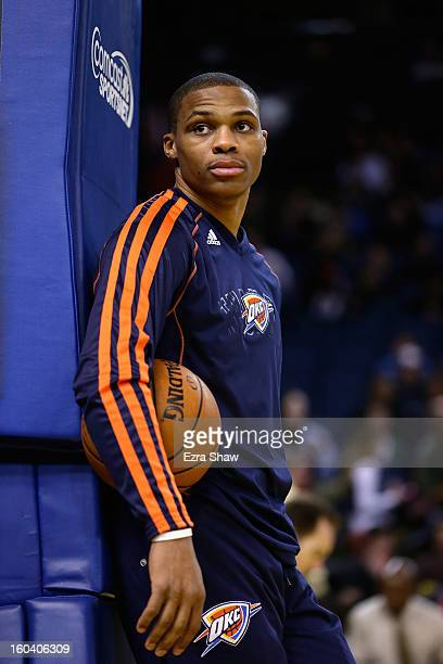 Russell Westbrook of the Oklahoma City Thunder warms up before their game against the Golden State Warriors at Oracle Arena on January 23 2013 in...