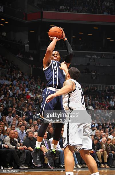 Russell Westbrook of the Oklahoma City Thunder wears the Jordan Brand XX8 sneakers as he shoots against Deron Williams of the Brooklyn Nets on...
