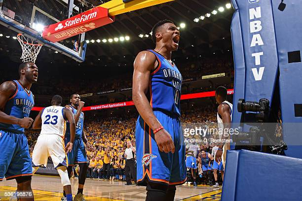 Russell Westbrook of the Oklahoma City Thunder yells to celebrate during Game Seven of the Western Conference Finals against the Golden State...