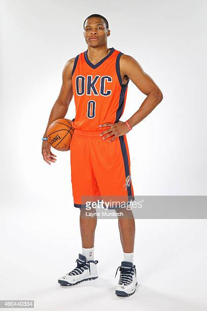 Russell Westbrook of the Oklahoma Thunder poses with the team's new Sunset uniform on September 23 2015 at the Integris Health Thunder Development...