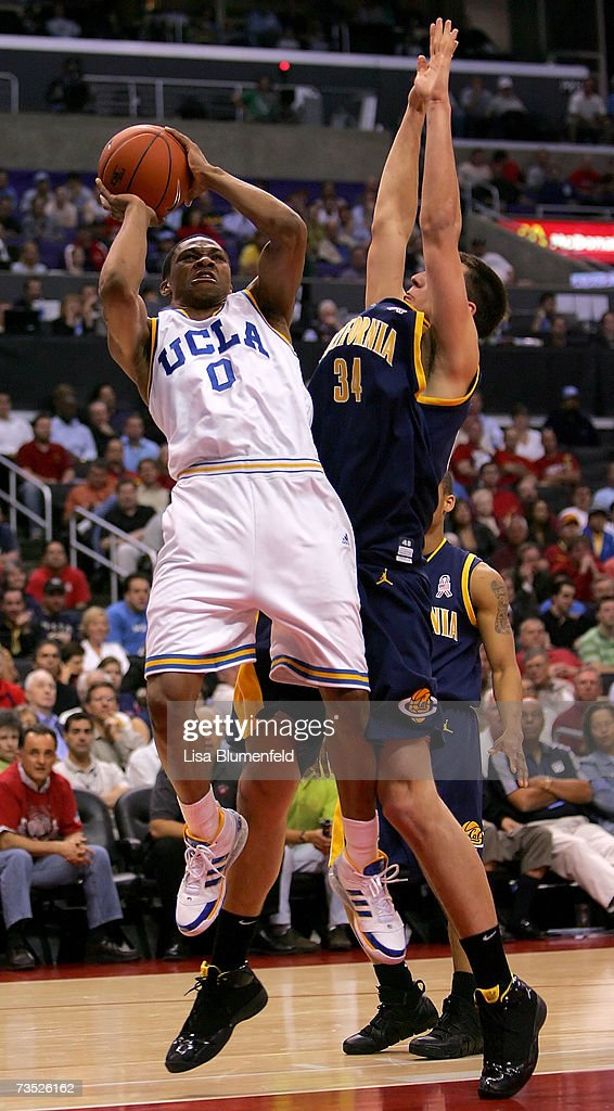Russell Westbrook of the UCLA Bruins shoots over the defense of Ryan Anderson of the California Golden Bears during the first half of the...