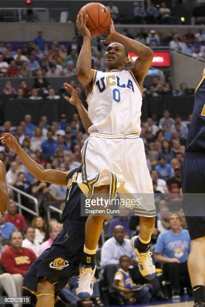 Russell Westbrook of the UCLA Bruins shoots over the defense of the California Golden Bears during the 2008 Pacific Life Pac10 Men's Basketball...