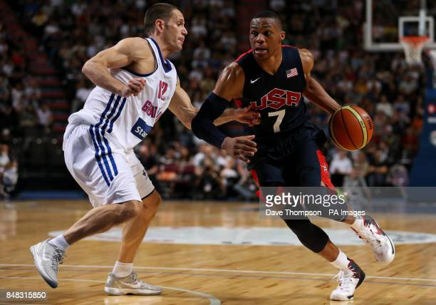 Russell Westbrook of the USA gets past Great Britain's Nate Reinking during an Olympic Warm Up match at the Manchester Arena Manchester