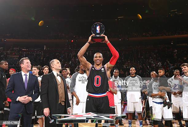 Russell Westbrook of the Western Conference AllStar Team is awarded the Kia NBA AllStar Game MVP trophy during the 64th NBA AllStar Game presented by...