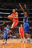 Russell Westbrook of the Western Conference AllStars goes up for a shot against Joe Johnson of the Eastern Conference AllStars in the 2011 NBA...