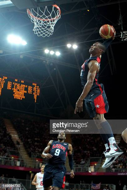 Russell Westbrook of United States dunks the ball against Tunisia during the Men's Basketball Preliminary Round match on Day 4 of the London 2012...