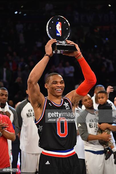 Russell Westbrook playing for the West Coast allstars holds up the KIA MVP Award during the 2015 NBA AllStar Game at Madison Square Garden on...