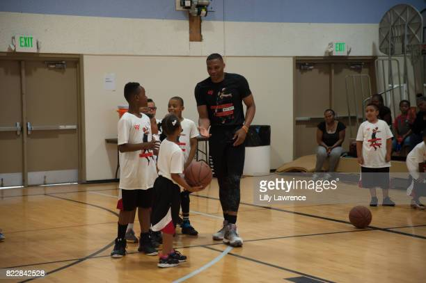 Russell Westbrook plays basketball with kids at Russell Westbrook 5th Annual Why Not Foundation Basketball Camp at Jesse Owens Community Regional...