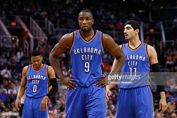 Russell Westbrook Serge Ibaka and Enes Kanter of the Oklahoma City Thunder during the NBA game against the Phoenix Suns at Talking Stick Resort Arena...