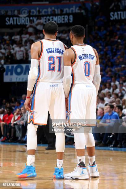 Russell Westbrook talks with Andre Roberson of the Oklahoma City Thunder during the game against the Houston Rockets during the Western Conference...