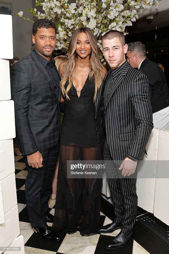 Russell Wilson; Ciara and Nick Jonas attend The Daily Front Row Fashion Los Angeles Awards Private Dinner Hosted By Eva Chow And Carine Roitfeld at Mr Chow on March 20, 2016 in Beverly Hills, California.