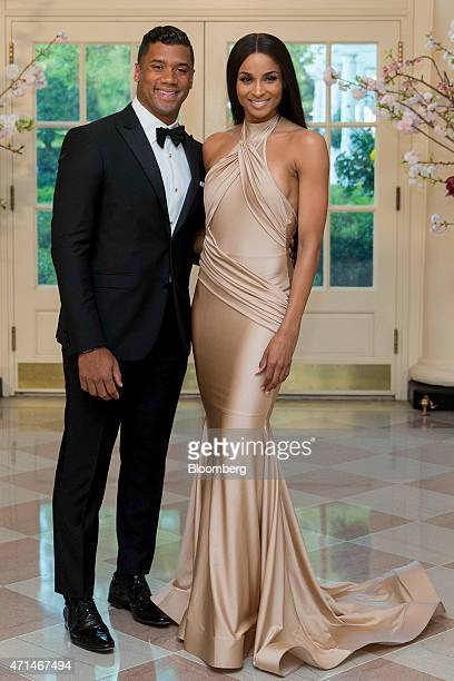 Russell Wilson National Football League quarterback for the Seattle Seahawks left and singer Ciara Harris arrive at a state dinner hosted by US...