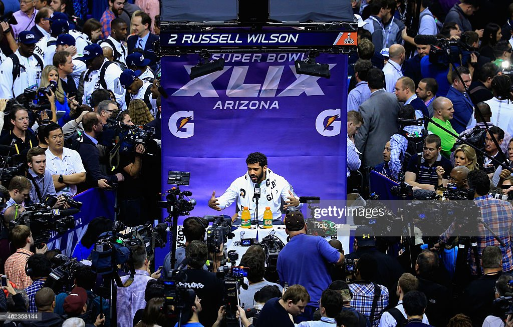 Russell Wilson #3 of the Seattle Seahawks addresses the media at Super Bowl XLIX Media Day Fueled by Gatorade inside U.S. Airways Center on January 27, 2015 in Phoenix, Arizona.