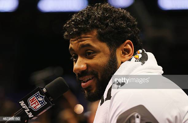 Russell Wilson of the Seattle Seahawks addresses the media at Super Bowl XLIX Media Day Fueled by Gatorade inside US Airways Center on January 27...