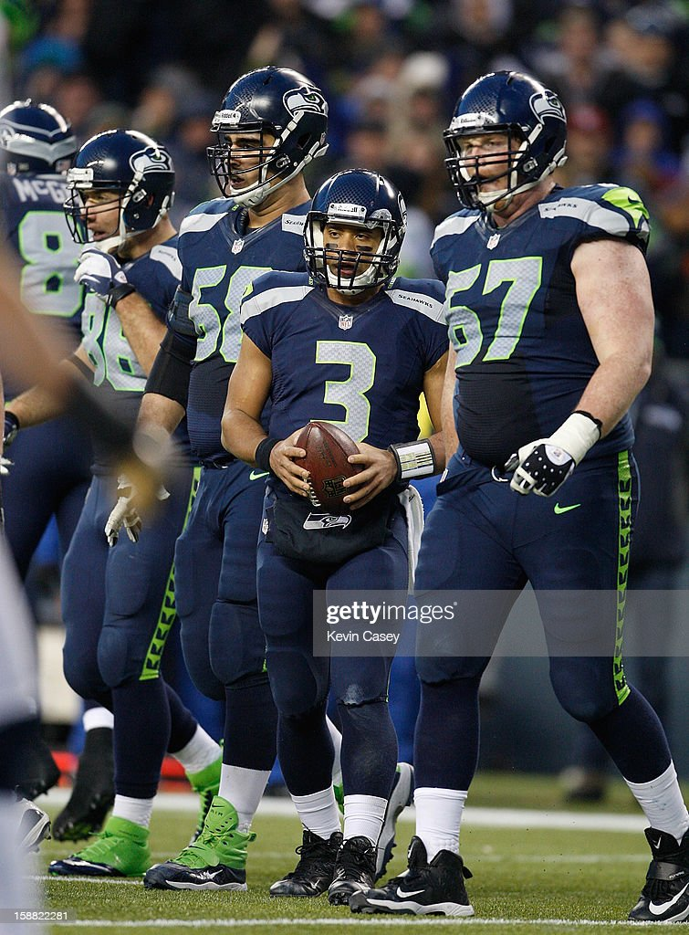<a gi-track='captionPersonalityLinkClicked' href=/galleries/search?phrase=Russell+Wilson+-+American+Football+Quarterback&family=editorial&specificpeople=2292912 ng-click='$event.stopPropagation()'>Russell Wilson</a> #3 of the Seattle Seahawks after scoring the go ahead touchdown rushing against the St. Louis Rams in the second half at CenturyLink Field on December 30, 2012 in Seattle, Washington.