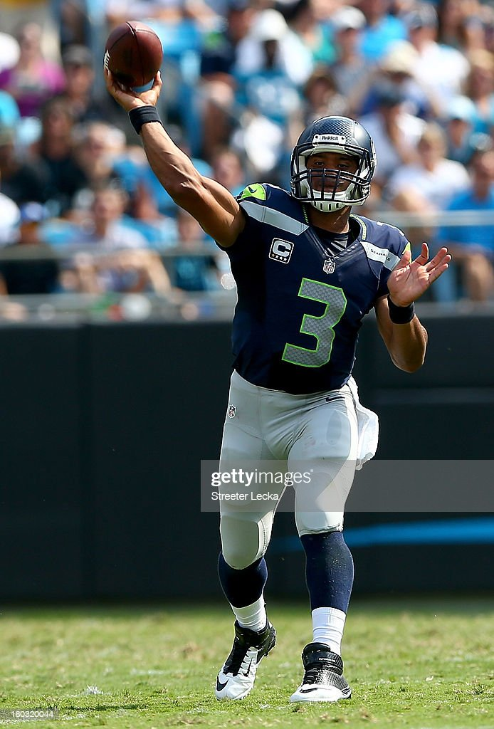 <a gi-track='captionPersonalityLinkClicked' href=/galleries/search?phrase=Russell+Wilson+-+American+Football+Quarterback&family=editorial&specificpeople=2292912 ng-click='$event.stopPropagation()'>Russell Wilson</a> #3 of the Seattle Seahawks against the Carolina Panthers during their game at Bank of America Stadium on September 8, 2013 in Charlotte, North Carolina.